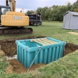 Composter anchored to concrete